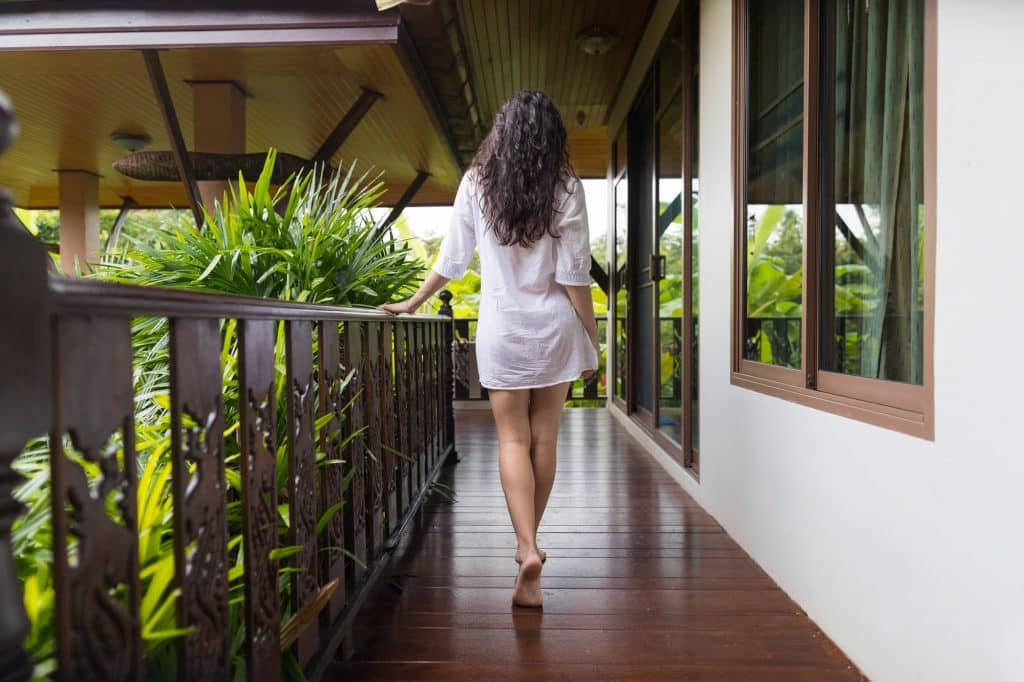 Young Girl On Hotel Terrace, Tropical Forest Beautiful Woman Back Rear View Summer Vacation